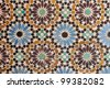 Moroccan traditional tiled mosaic covering a wall at Marrakesh, Morocco. - stock photo
