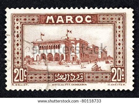 MOROCCO - CIRCA 1932: Stamp printed in Morocco showing the Hotel des PTT Casablanca, circa 1932.
