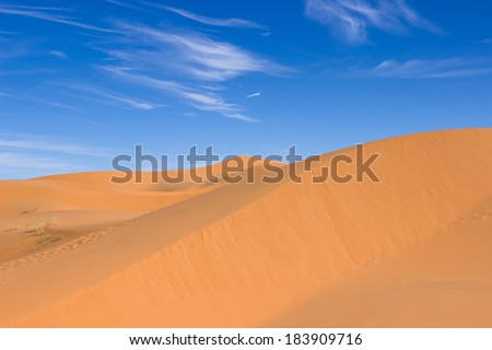 MOROCCO - JANUARY 10, 2014: Sahara desert dunes, white clouds - stock photo