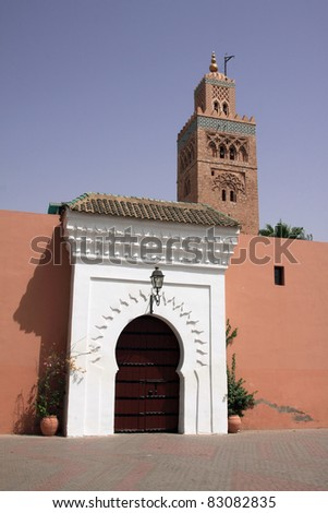 Morocco Marrakesh Beautiful Arabesque door and the Koutoubia Mosque minaret - stock photo