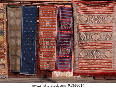 Morocco Marrakesh Colorful Berber carpets for sale hanging in the Jemaa El Fna Square - stock photo