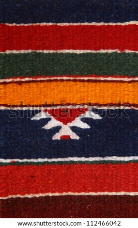 Morocco  Marrakesh Detail of Berber traditional woollen rug - natural dyes and typical ancient Berber symbol - stock photo