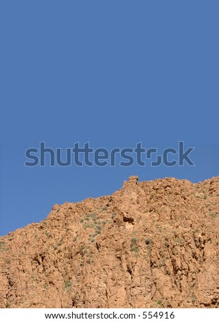 Morocco orange mountains against intense blue sky