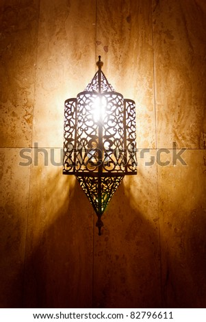 Morocco:  Ornate metal lamp in the wall of a mosque, Morocco. - stock photo