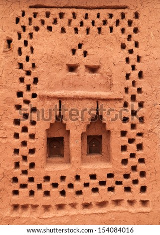 Morocco Ouarzazate - Ait Ben Haddou Medieval Kasbah built in adobe - UNESCO World Heritage Site. Detail of a typical Berber tribal geometrical exterior wall decoration. - stock photo