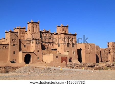 Morocco, Ouarzazate, Skoura, Amridil Kasbah The towers decorated with Berber geometrical symbols. The kasbah is depicted in Morocco's 50 Dirham banknotes.   - stock photo