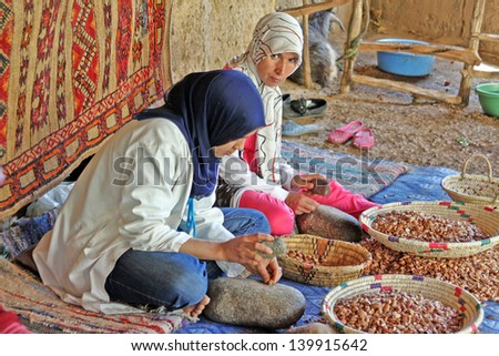 MOROCCO, OURIKA VALLEY - MAY 28: Women work in a cooperative for the manufacturing of argan fruits on May 28, 2012 in Ourika valley, Morocco - stock photo