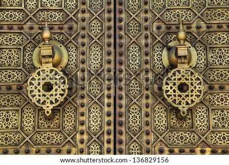 Morocco, Rabat, detail of typical old arabesque intricate engraved brass door in Islamic design - stock photo