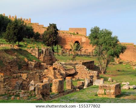 Morocco, Rabat, stone rampart wall surrounding the Roman ruins of Chellah known as Sala in Roman times. UNESCO World Heritage site - stock photo