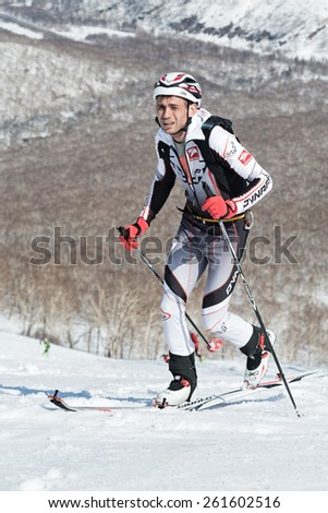 MOROZNAYA MOUNT, KAMCHATKA, RUSSIA - APRIL 25, 2014: Ski mountaineer Aleksei Zagorskiy climb on skis on mountain. Vertical race ski mountaineering Asian, ISMF, Russian, Kamchatka Championship.