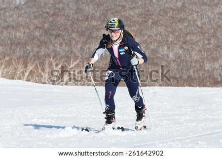 MOROZNAYA MOUNT, KAMCHATKA, RUSSIA - APRIL 25, 2014: Ski mountaineer Berezan Svetlana climb on skis on mountain. Vertical race ski mountaineering Asian, ISMF, Russian, Kamchatka Championship. - stock photo