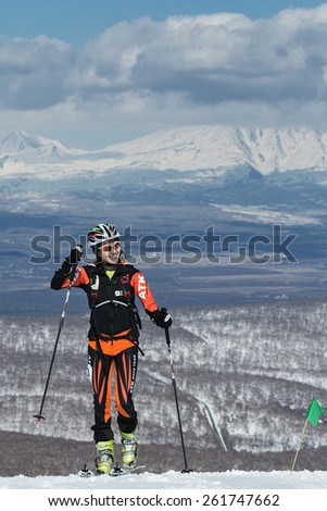 MOROZNAYA MOUNT, KAMCHATKA, RUSSIA - APRIL 25, 2014: Ski mountaineer Ma Nan from China climb on skis on mountain. Vertical race ski mountaineering Asian, ISMF, Russian, Kamchatka Championship. - stock photo