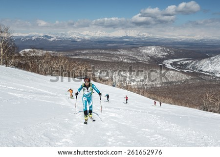 MOROZNAYA MOUNT, KAMCHATKA, RUSSIA - APRIL 25, 2014: Ski mountaineers climb on skis on mountain. Vertical race ski mountaineering Asian, ISMF, Russian, Kamchatka Championship. - stock photo