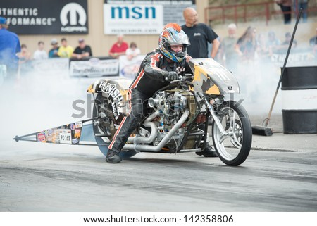 Morrison, CO - June 15, 2013: Bike PD 265 burns out during Thunder on the Mountain presented by Grease Monkey at Bandimere Speedway. - stock photo