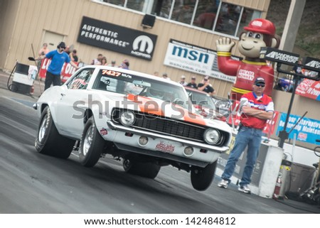 Morrison, CO - June 16, 2013: Car 7427 Super Stock does a wheelie at the start line during Thunder on the Mountain presented by Grease Monkey at Bandimere Speedway. - stock photo