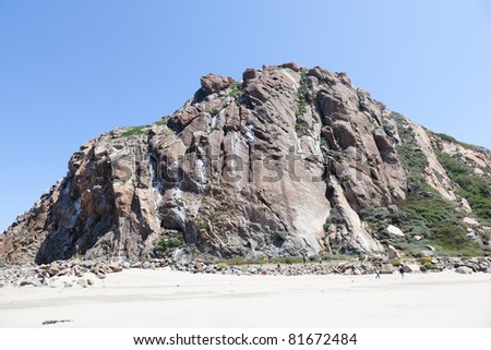 Morro Rock is a 581-foot (177 m) volcanic plug located just offshore from Morro Bay, California - stock photo