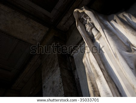 mortal statue from a graveyard - stock photo