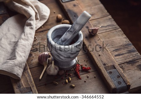 Mortar and hot pepper. Food background. Shallow DOF - stock photo