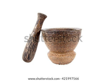 Mortar and pestle made of coconut wood isolated on white background