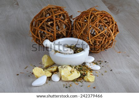 Mortar and pestle with homemade natural and organic products  - stock photo