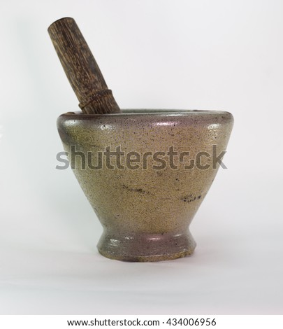 Mortar and Wooden sticks for grinding spices in Thailand.