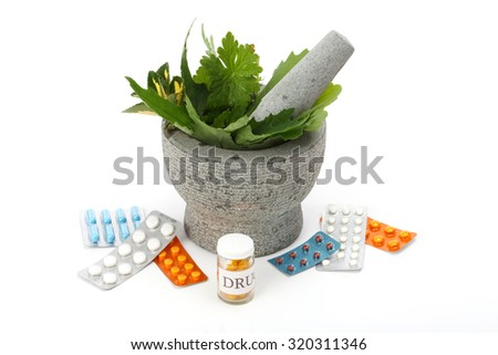 Mortar, pestle, herbs and pills over white.  - stock photo