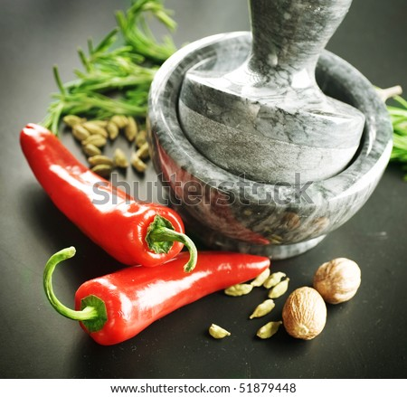 Mortar with pestle, Herbs and Spices.Over black background - stock photo