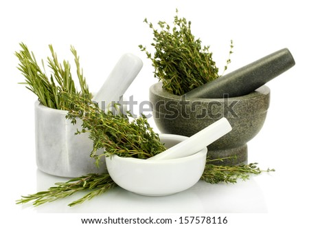 mortars with fresh green thyme and rosemary isolated on white - stock photo