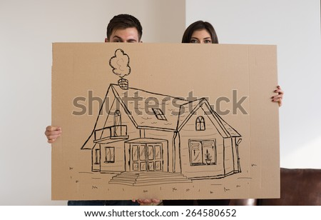 Mortgage and credit concept. Young couple relocating to new home - stock photo