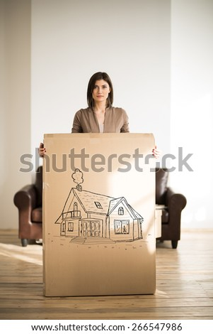 Mortgage and credit concept. Young woman relocating to new home and planning future - stock photo