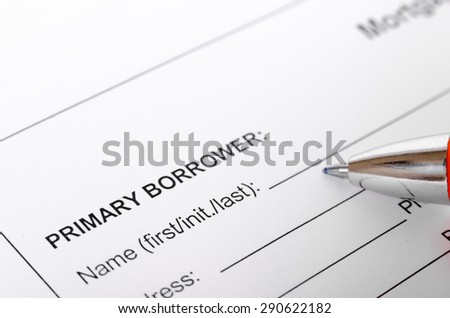 Mortgage application form close up with borrower information and pen. selective focus, shallow depth of field - stock photo