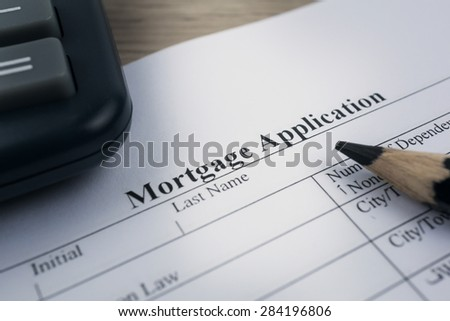 Mortgage application form with a calculator and pen - stock photo