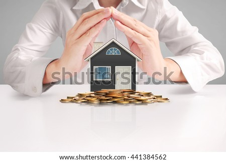 Mortgage concept by house from in hand - stock photo