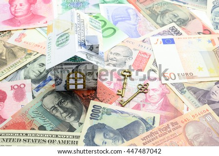 Mortgage concept : Dollar paper house with two vintage brass keys on banknotes of the dominant countries. A mortgage is a debt instrument, secured by the collateral of specified real estate property.