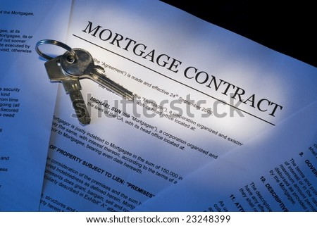 Mortgage contract for sale of real estate property with a pen and house keys - stock photo