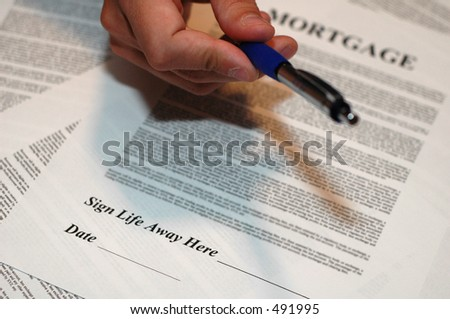 Mortgage Documents with Hand Holding Pen