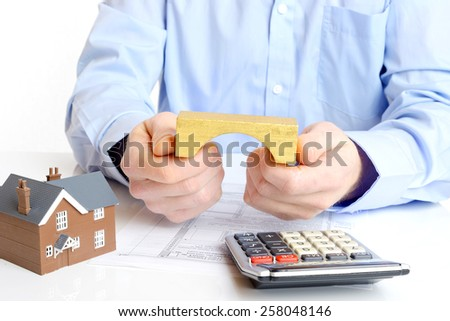 Mortgage loan or bridging application with house - stock photo