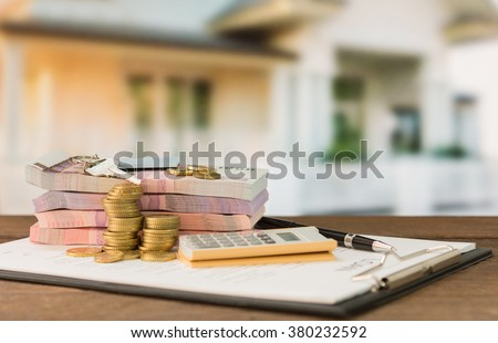 Mortgage, money, banknote, calculator, keys house on loan agreement or contract document with real estate property background. - stock photo