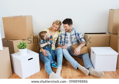 mortgage, people, housing and real estate concept - happy family with boxes moving to new home - stock photo