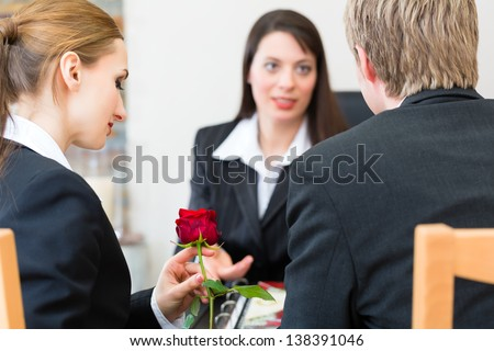 Mortician is advising clients for the funeral and is giving them solace - stock photo