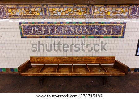 mosaic and old bench at Jefferson Street Subway Station in Brooklyn, New York City - stock photo