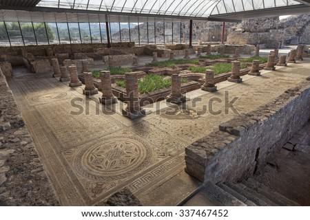 Mosaic and ruins in House of the fountains in Conimbriga, Portugal - stock photo