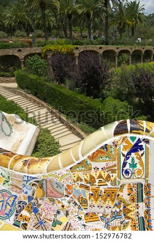Mosaic bench at Parc Guell in Barcelona, designed by famous Catalonian architect Antoni Gaudi - stock photo
