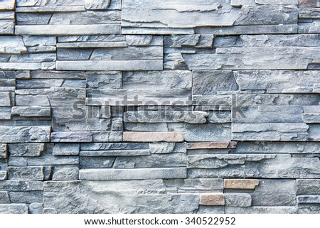 Mosaic brick wall background in the modern garden - stock photo