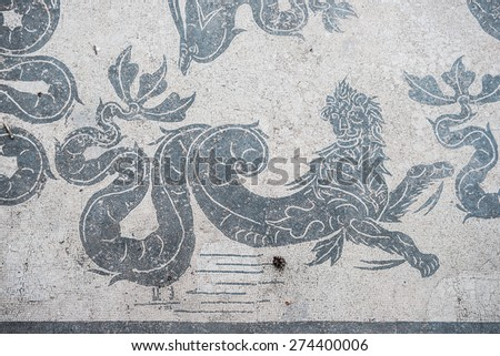 Mosaic details in the old town of Ostia, Rome, Italy. Ruins of an ancient roman thermal establishment with mosaic on the floor, heritage of early italian history, now travel destination for tourists. - stock photo