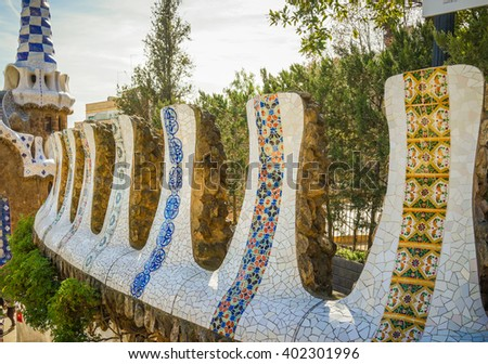Mosaic Fence at Park Guell Designed by Antoni Gaudi - Barcelona, Spain. - stock photo