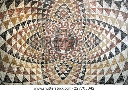 Mosaic of Dionysos, from the ruins of central panel from tesselated floor of a Roman villa (second half 2nd Century BCE). Depicted is Dionysos with fruit and ivy in his hair. Corinth, Greece.  - stock photo