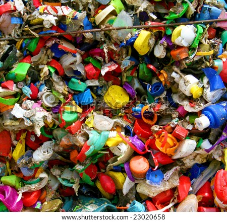 mosaic of plastic bottle tops in recycling plant in Germany - stock photo