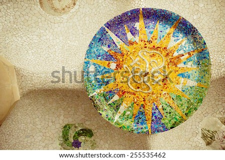 Mosaic on the ceiling in the Park Guell - stock photo