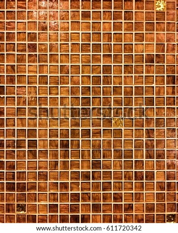mosaic tile texture background in brown and orange color.